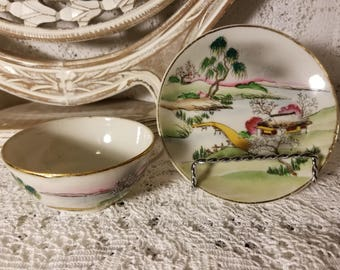 Japanese hand painted tea cup and saucer