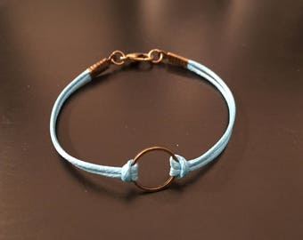 Arband light blue with circle and closure
