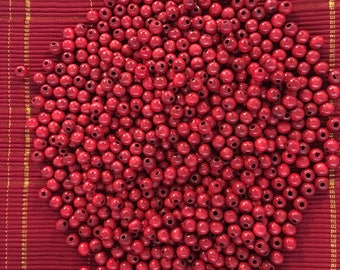 500 red wood beads