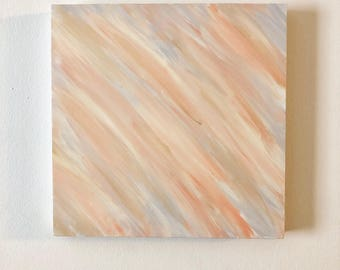 Neutral tones on wooden board