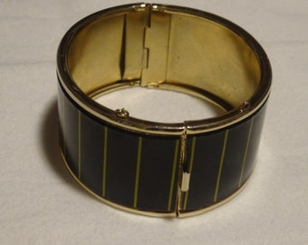 Black and Gold clasp arm bracelet