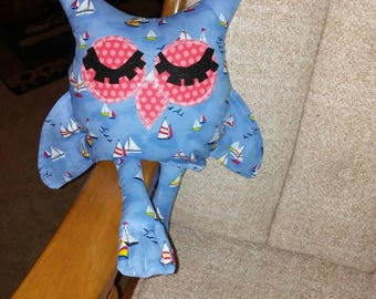 Owl for babies nursery in cotton sailboat theme on blue background. Hypoallergenic stuffing. Felt eyelids. Measures 16 long. Webbed feet.