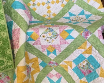 Cheerful Spring Sampler Quilt, lap size quilt in pink, yellow, blue and green floral fabric, sofa throw, large baby blanket, patchwork throw