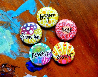 activism set: show up. begin. resist. rise. persist. - buttons with pin back