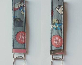 Fallout Nuka Cola Vaultboy - Key Fob Wristlet