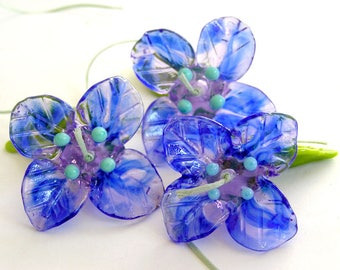 Handmade lampwork beads 2 focal flowers in blue with 3 leaves