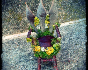 Faery velvet chair of wisteria pods, twigs, and horse chestnut