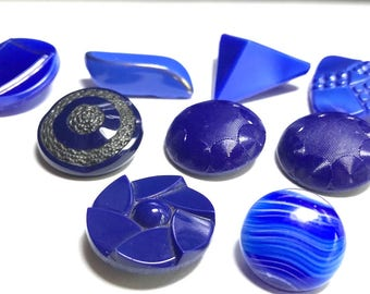 Group Of Eight  Blue Glass Buttons   Different Shapes And Sizes