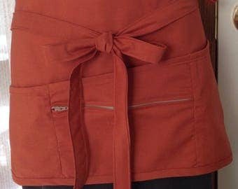 Vendor apron with zippered pocket terra cotta color