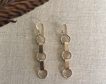 Gold chain link earrings by Ankh By Racquel