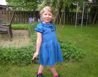 Toddler dress inspired by the Lucy Van Pelt dress from You're a good man Charlie Brown comics. Bow and bloomer are included for this month