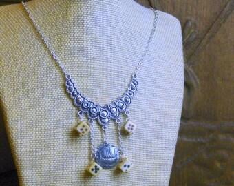 SALE Liar's Dice Pirate Games Vintage bone scrimshaw dice, ship emblem button and metal bib necklace