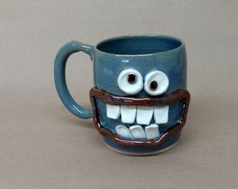 Nelson Studio Ug Chug Face Mug. Funny Blue Coffee Cups and Mugs. Handmade Ceramic Stoneware Pottery Dishes. Hilarious Average Joe Guys Mugs