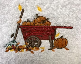 Wheelbarrow and Pumpkins embroidered hand towel