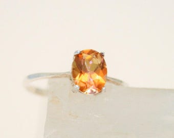 Orange crystal and sterling silver ring. UK size P. US size 7 3/4