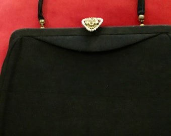 Vintage black crepe evening clutch with a rhinestone clasp