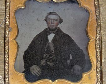 Ambrotype of A Man with Bright Pink Cheeks and Very Large Hands.