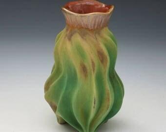 Organic porcelain carved vase in green, tan, orange, cactus like