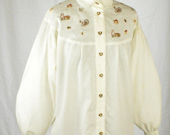 70s folkloric cream smock blouse with peter pan collar embroidered with forest creatures, toadstools, oak leaves and acorns size L