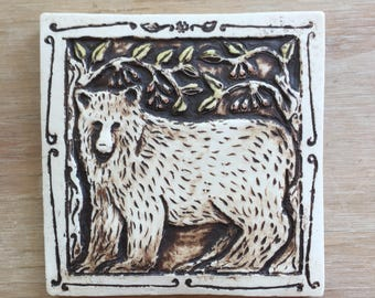 Handmade ceramic black bear tile