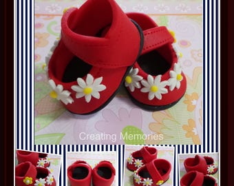 Red baby girl shoes with daysis Cake Topper Made of Vanilla Fondant ready to place on your cake or table centerpiece