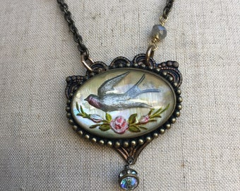 Reversed painted swallow assemblage necklace