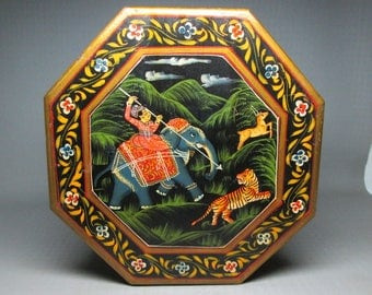 Painted box from India , octagon shape , no marks , not sure of the age but it has lots of hand work and nice details