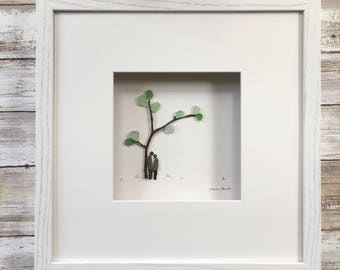 Pebble Art by Sharon Nowlan, romantic pebble art comes matted or framed in 12 by 12 frame.