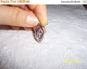 TWICE A YEAR, 25% Off Vintage Dancing Diamond pendant. Sterling silver.