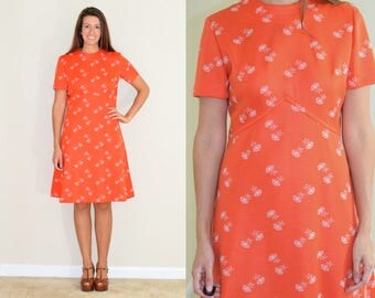 Vintage Orange Floral Pattern Dress with A Line Skirt and A Hem at Empire Waist
