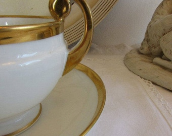 Antique French large pair of hot chocolate cups and saucers in old Porcelain de Paris.