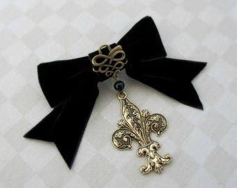 Black velvet bow with bronze colour fleur de lis filigree charm