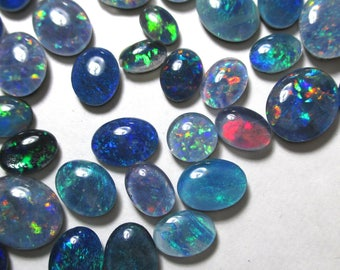 1 piece of opal triplet cabochon picked randomly from lot - each piece 0.35 to 1.30 carats in weight