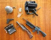 Vintage GI Joe accessories.  Toy guns.  Miniature toys.  War toys.