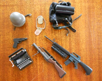 Vintage GI Joe accessories.  Toy guns.  Miniature toys.  War toys.