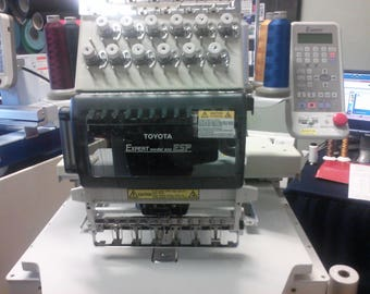 TOYOTA AD850 Commercial Embroidery Machine with 270 cap system