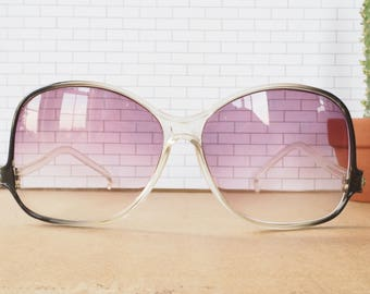 Vintage Sunglasses 1970's Oversized Clear and Black color By Foster Grant New Old Stock Made In Taiwan Lightly Tinted Purple lens Cheap!Cute