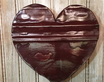 Ornate distressed dark red heart designed with antique tin ceiling tile