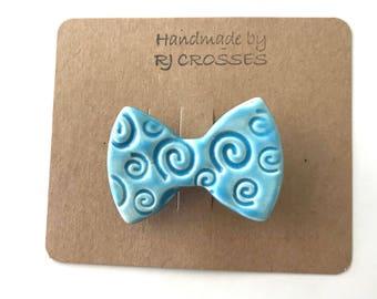 Light blue ceramic bowtie brooch
