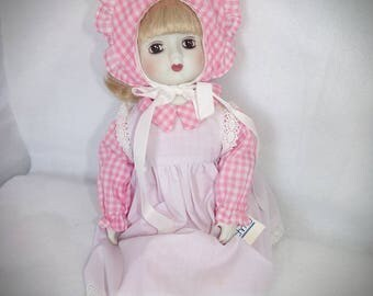 Summer Time Musical Porcelain Doll .  Schmid Porcelain  Pink Doll .  You are my Sunshine Doll.  Musical Doll . Pink Dolls .