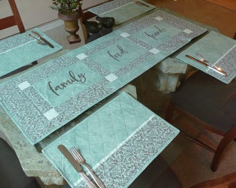 Turquoise/aqua and brown quilted table runner.  Family-Food-Friends Turquoise table runner. Aqua and brown dining table linens.