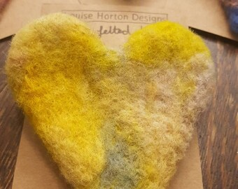 Needle felted heart brooch in yellows