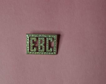 A Vintage Rectangular Rhinestone Pin With the Initials EBC