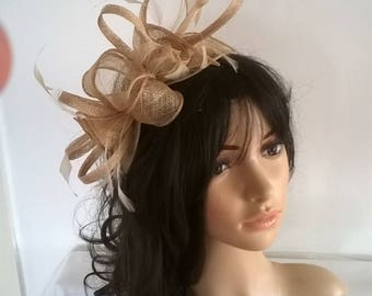 Stunning Pale Gold rosette Sinamay and  Feather Fascinator..on a headbandwith crystals
