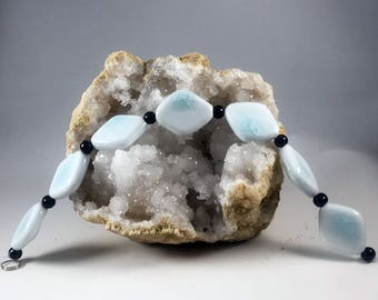 Various large ceramic light blue and white beads