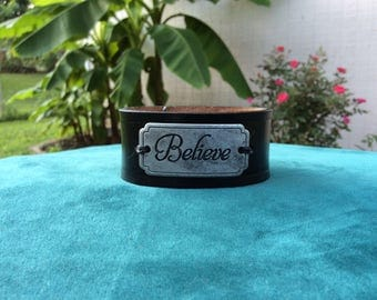 """Black Leather Cuff with a """"Believe"""" Plate"""