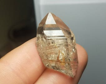 Quartz Crystal Point with Holmquistite inclusions Tanzania Q0055
