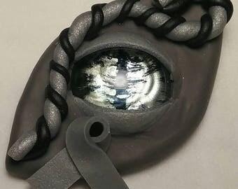 Silver ribbon dragon eye