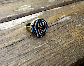 "liberty textile ring ""black, blue and orange tone"" brass"