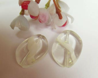 2 white and transparent glass beads